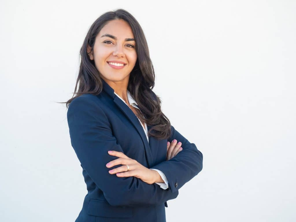 Smiling confident businesswoman posing with arms folded - she is proud to use Approovd - Swiss Streaming Platform for Contracts